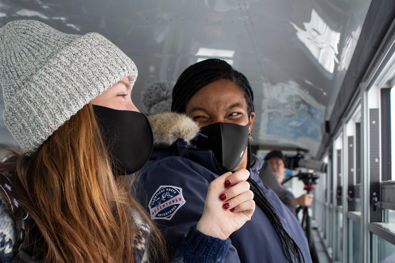 Travellers enjoying a Tundra Buggy adventure in Churchill, Canada