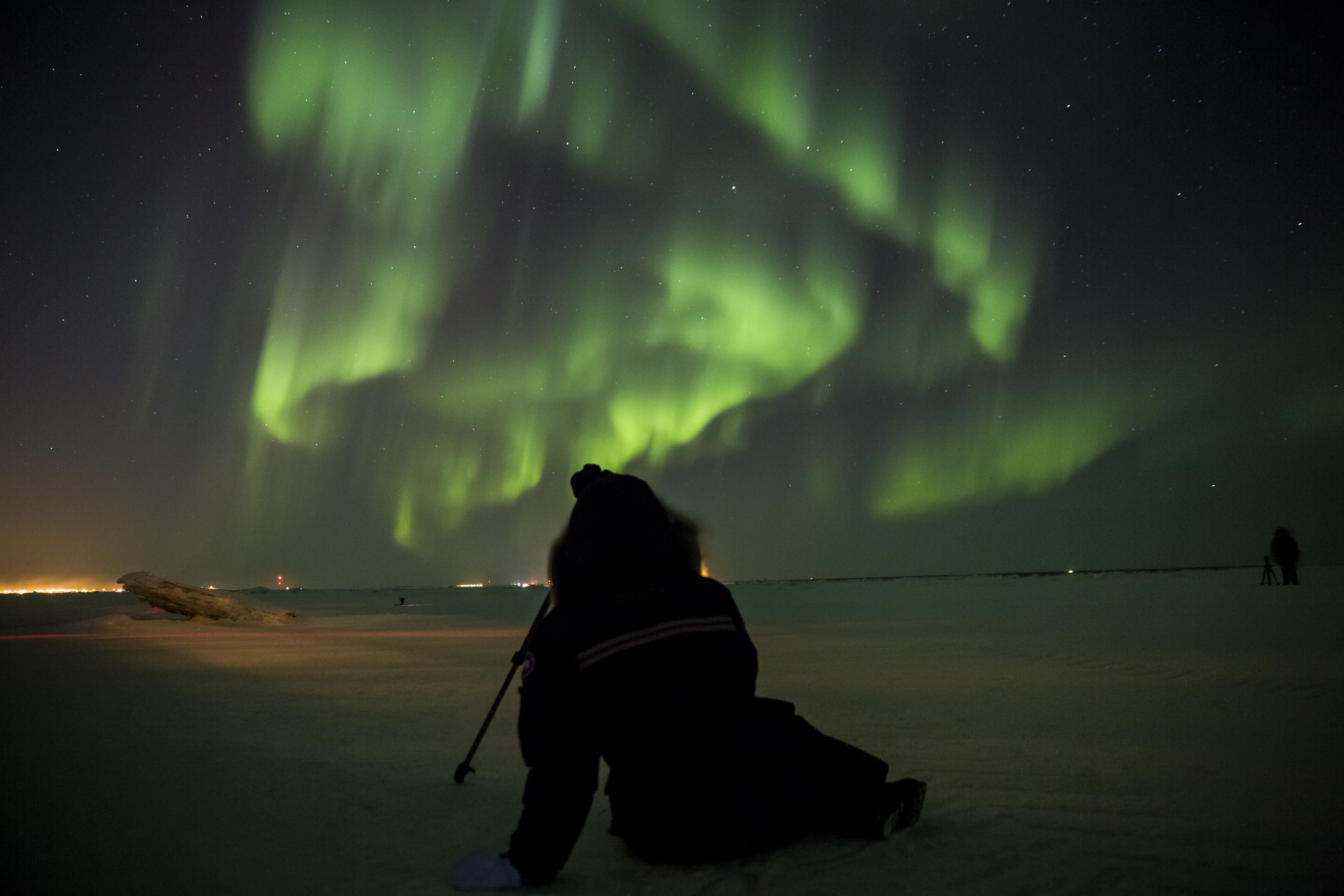 Sitting on the frozen tundra in Churchill, Manitoba enjoying the northern lights outside of Frontiers North's  Dan's Diner.