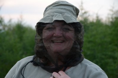 Woman in netting to avoid mosquitos.
