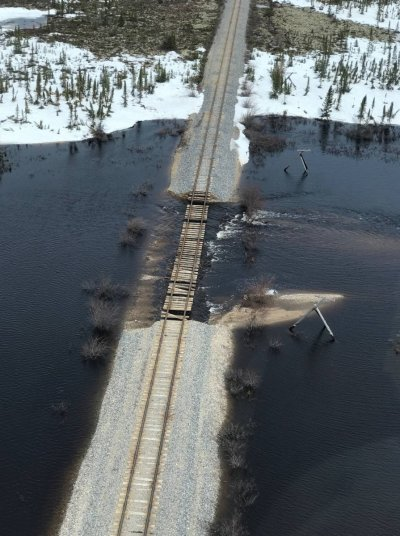 An aerial photo of washed out train tracks.