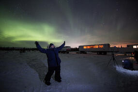 A person standing on the tundra in Churchill, Canada after the Dan's Diner culinary experience.