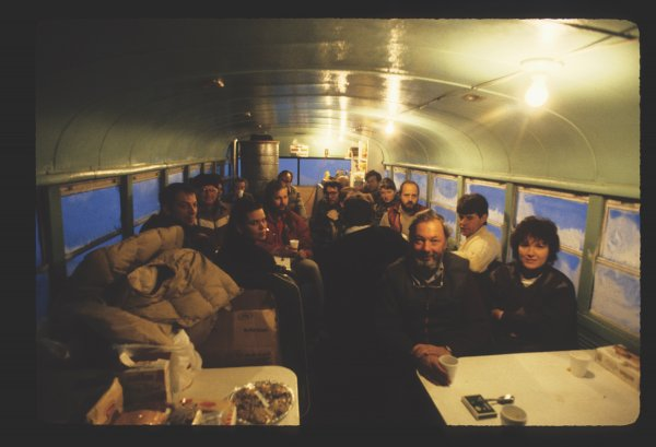 A group of pioneering guests enjoys drinks in the original Tundra Buggy®