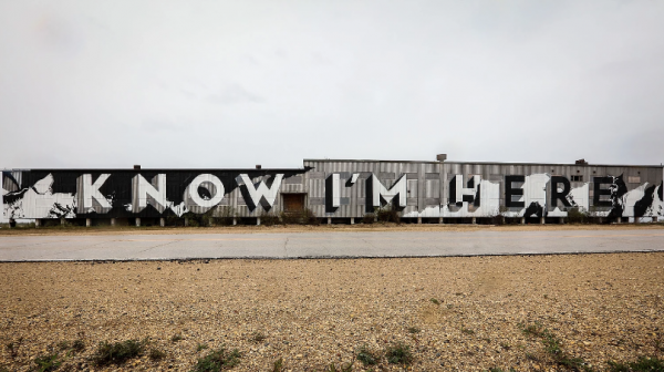 "A large mural reading ""Know I'm Here"" is painted on a building in Churchill, MB"