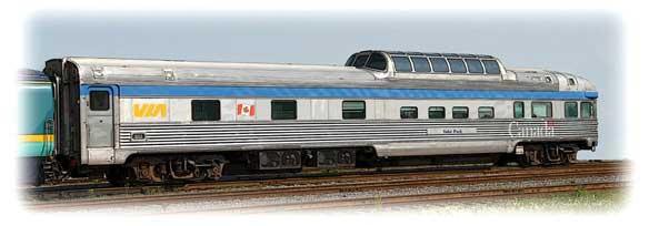 A VIA Rail park car at rest on tracks.